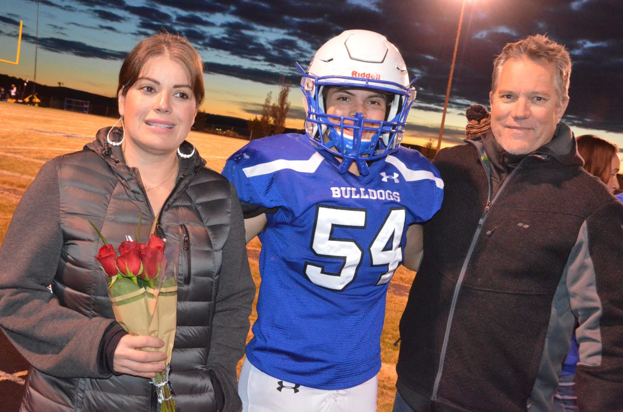 Moffat County High School's Angel Rodriguez is joined by parents as part of Senior Night.