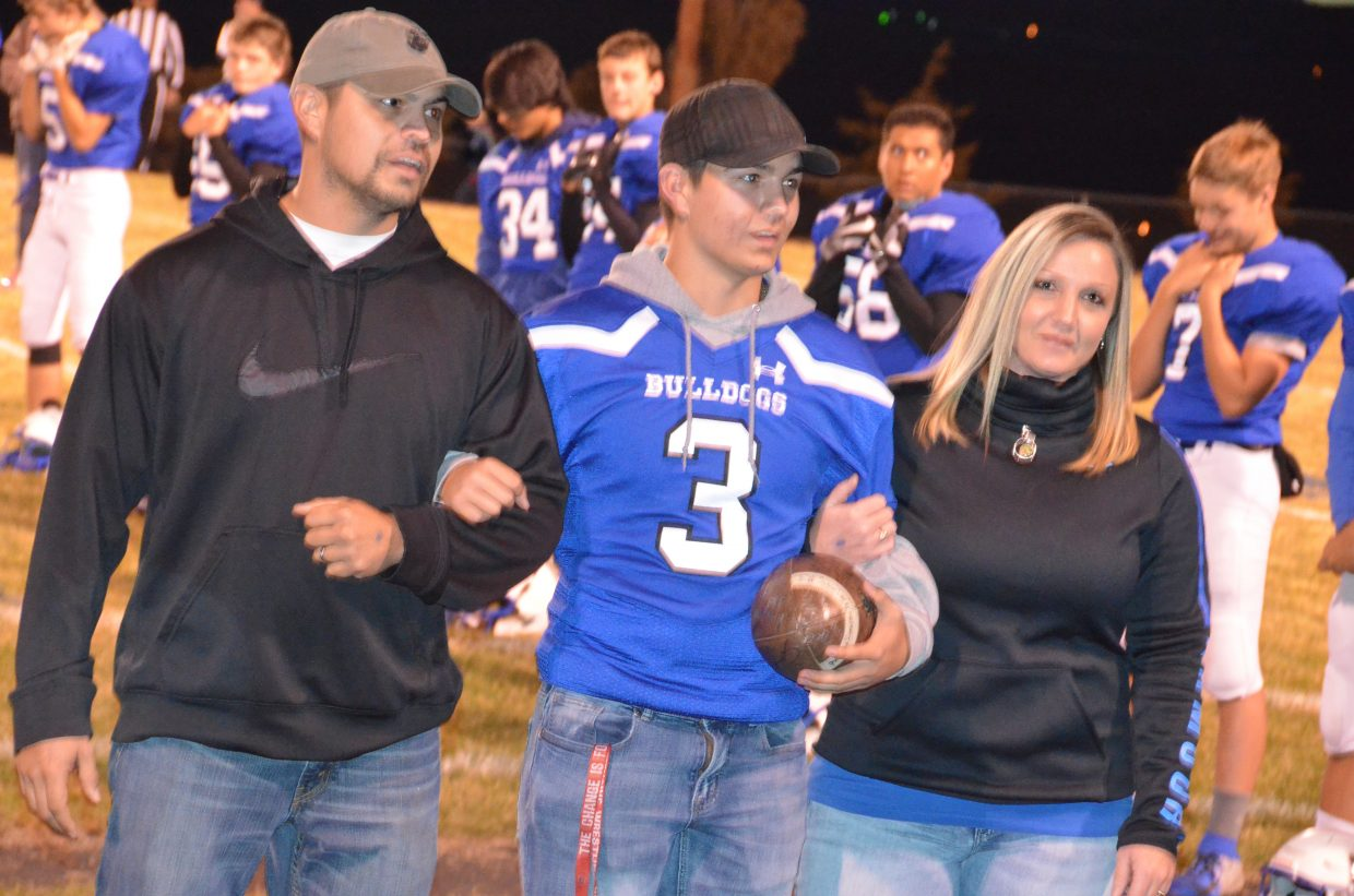Moffat County High School's Greg Hixson is joined by parents as part of Senior Night.
