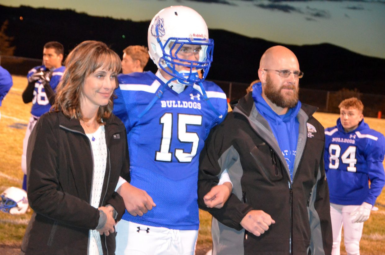 Moffat County High School's Colby Beaver is joined by parents as part of Senior Night.