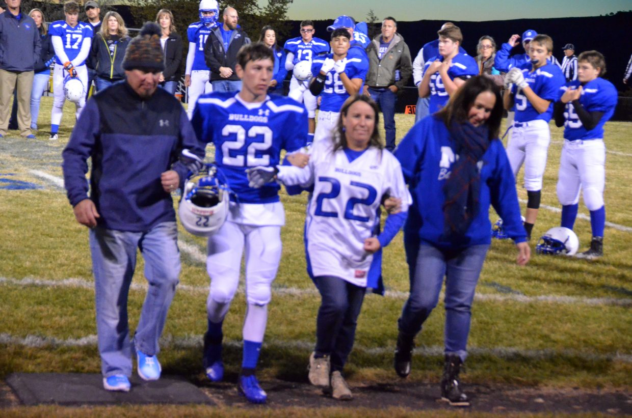 Moffat County High School's Connor Etzler is joined by family as part of Senior Night.