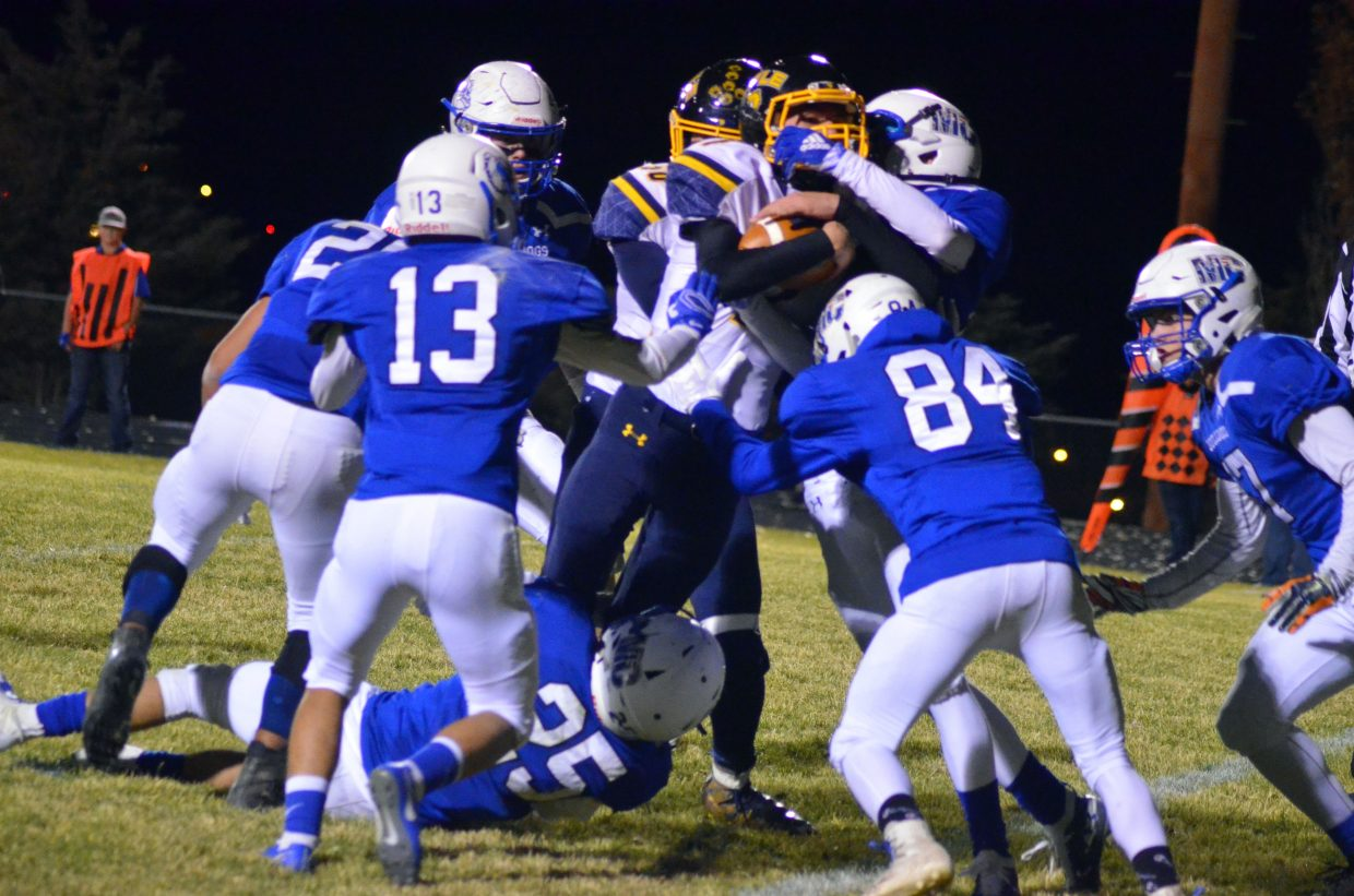 Moffat County High School defense stacks up to prevent a Rifle first down.