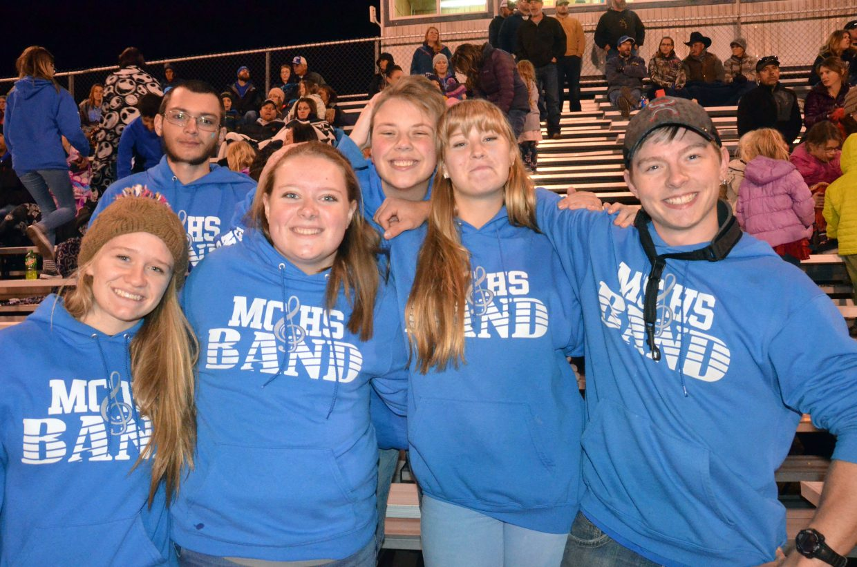 From left, Moffat County High School band seniors Molly Neton, James Brumblow, Caitlen Krause, Constantine Daniels, Abigail Fritz and Caymen Shepherd gather in the stands during halftime.