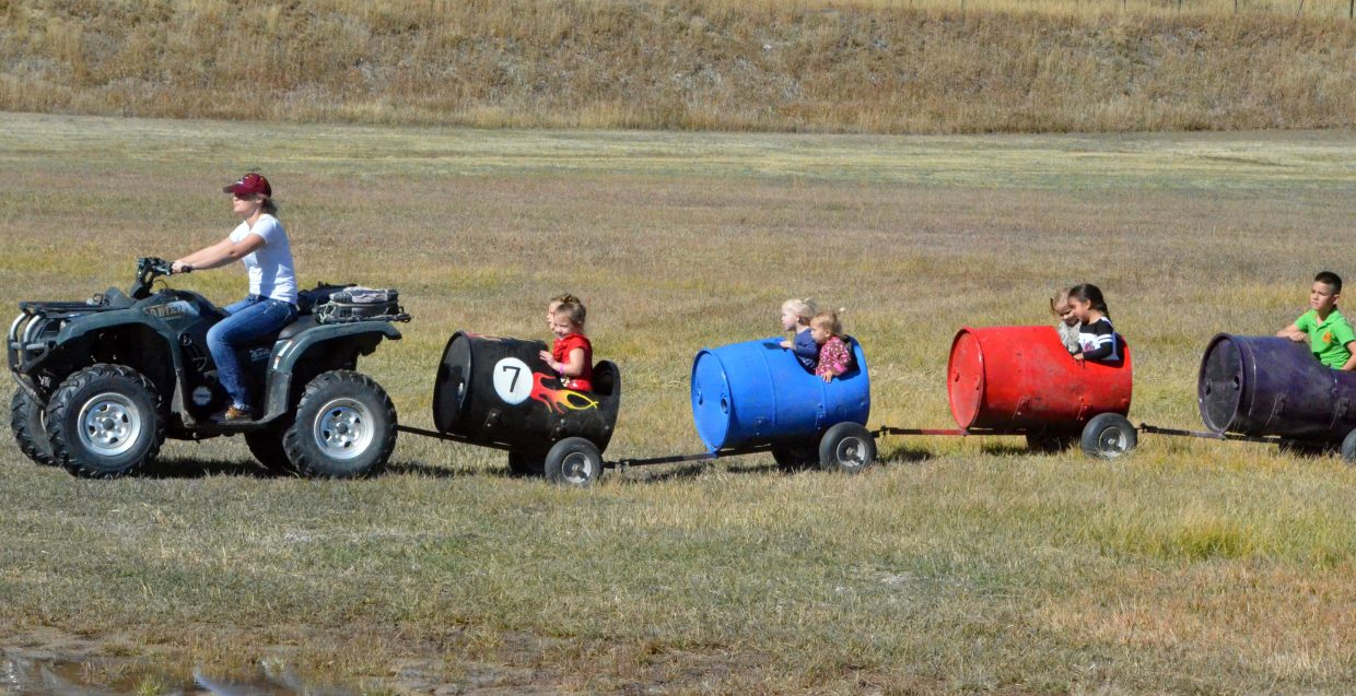 The kids train speeds along at Saturday's pumpkin patch at Wyman Living History Museum.