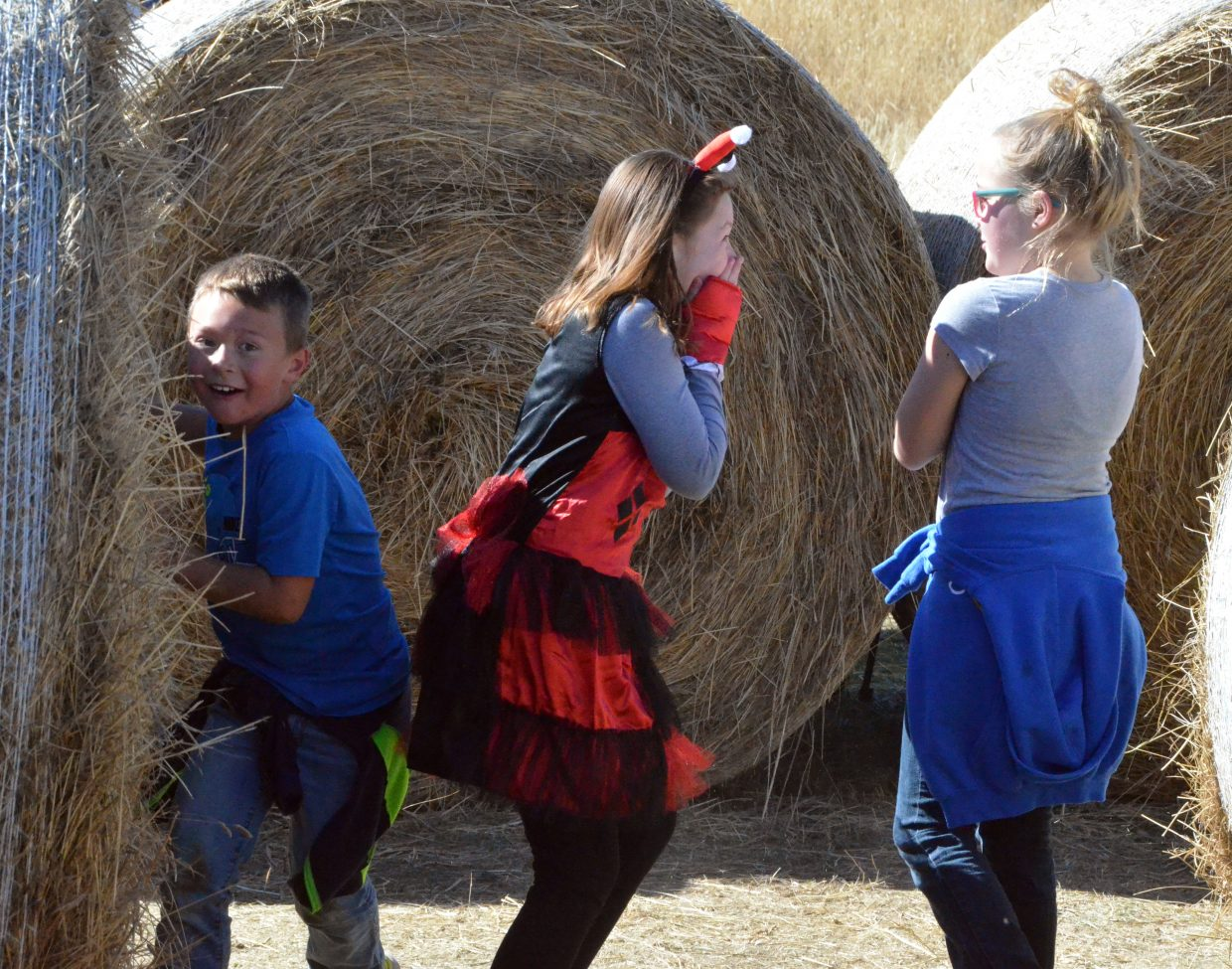 Kids dash around the hay maze as part of the pumpkin patch at Wyman Living History Museum.