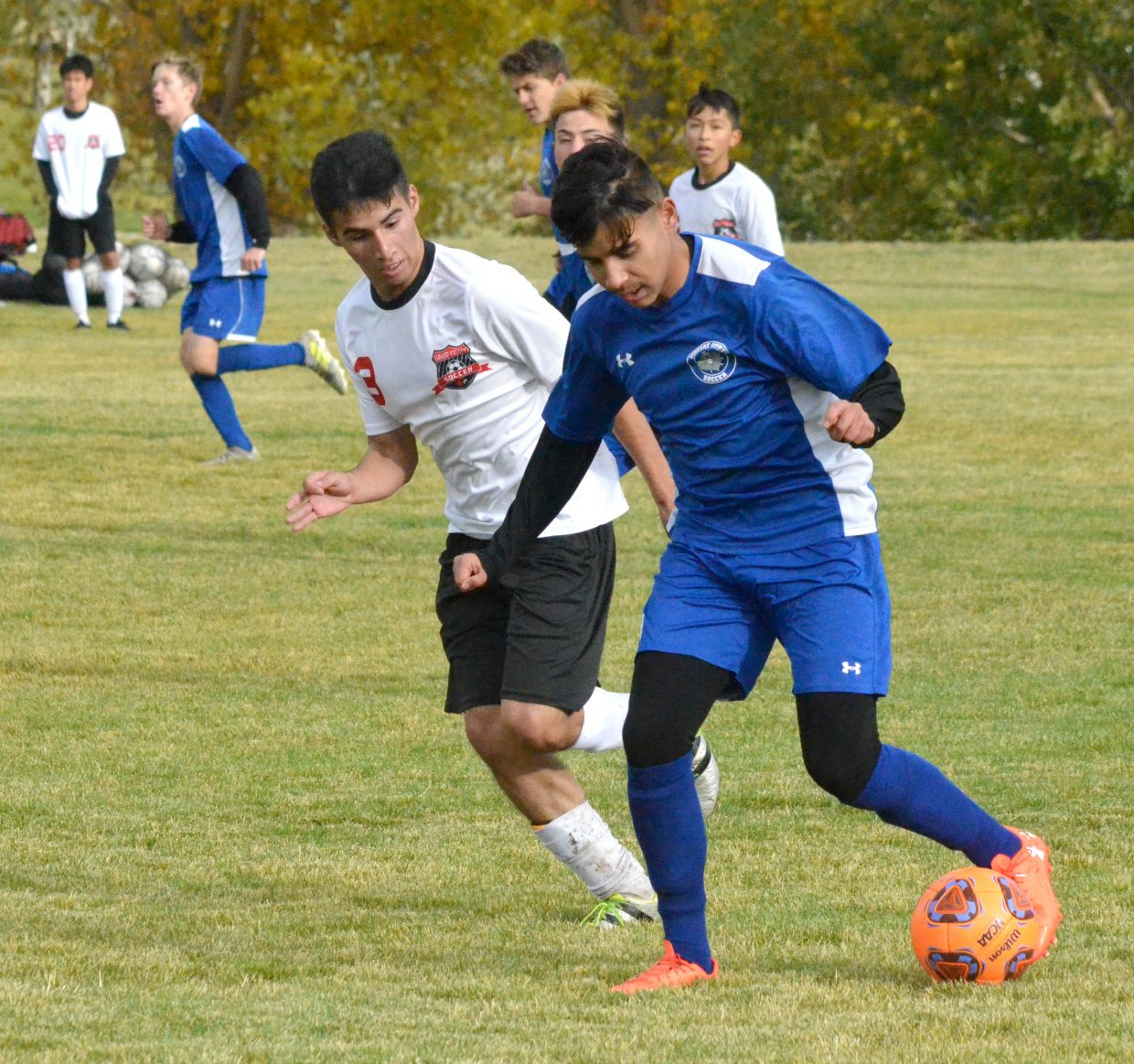 Moffat County High School's Christian Orona pushes the ball forward against Grand Valley.