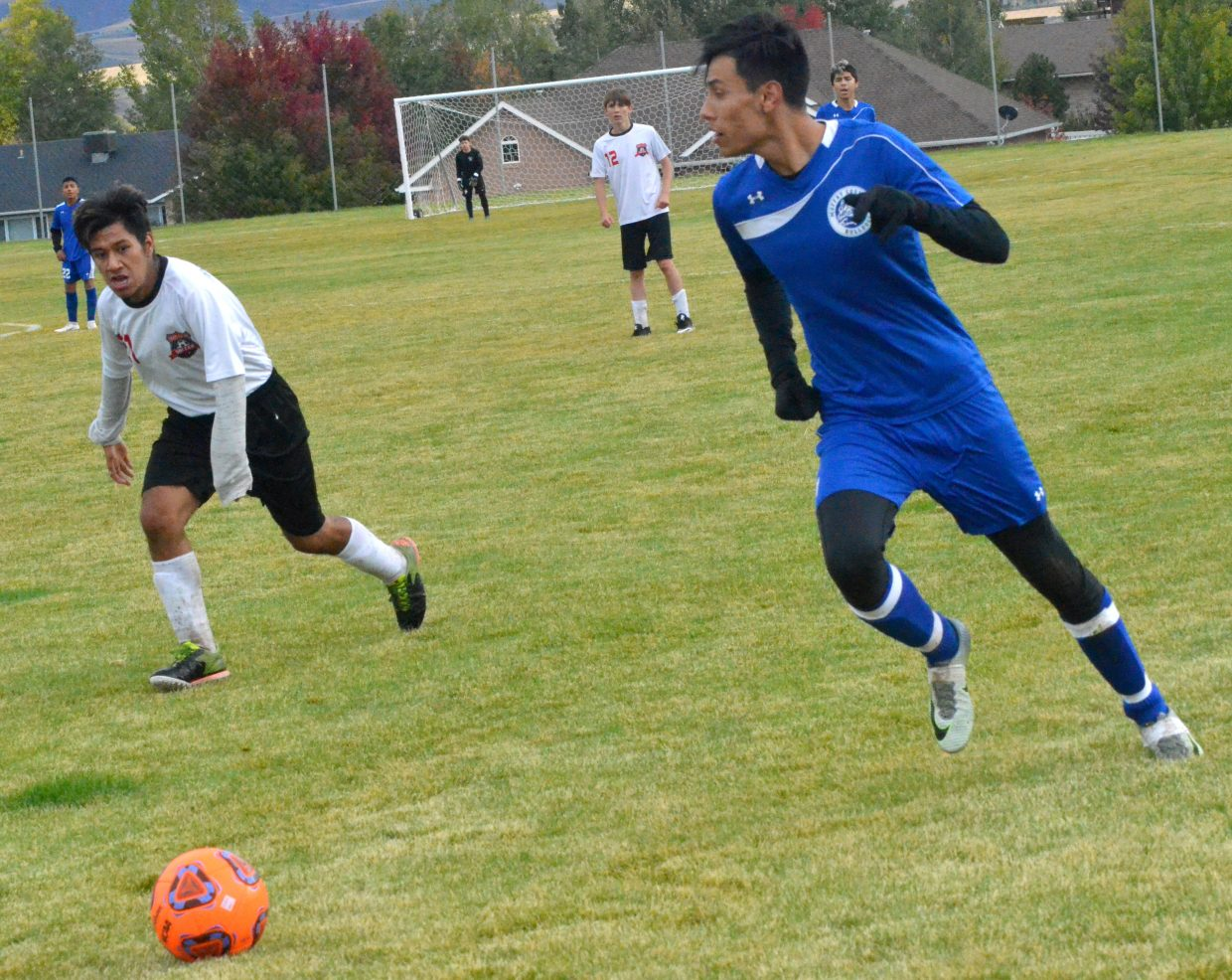 Moffat County High School's Axeel Mendoza moves past midfield and into Grand Valley territory.
