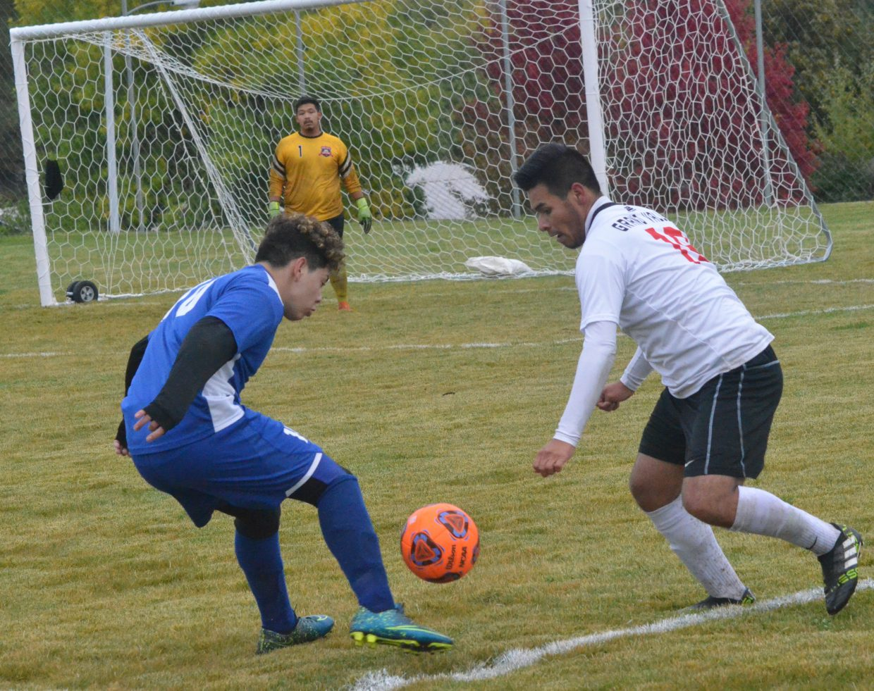 Moffat County High School's Miguel Zaragoza tangles with the Grand Valley defense.