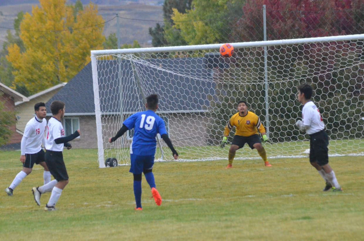 Moffat County High School's Christian Orona hopes for a score on a high shot against Grand Valley.