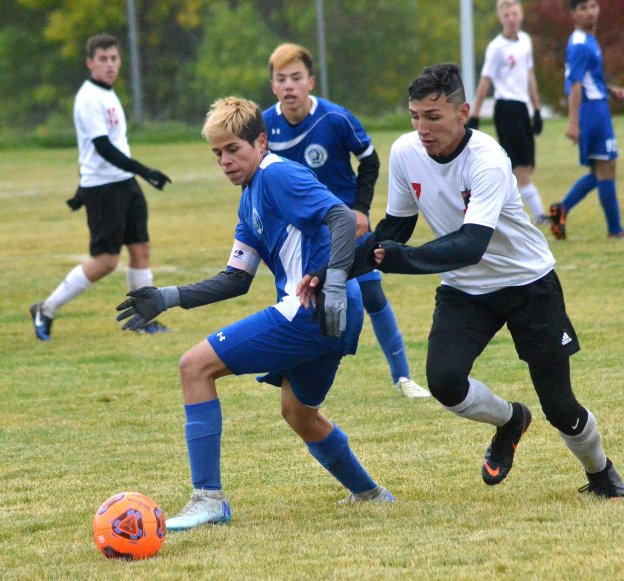 Moffat County High School's Pedro Romero retakes ball control from Grand Valley.