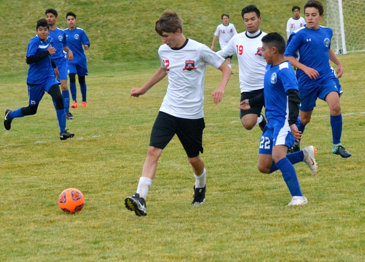 Moffat County High School soccer players  swarm their Grand Valley opponents.
