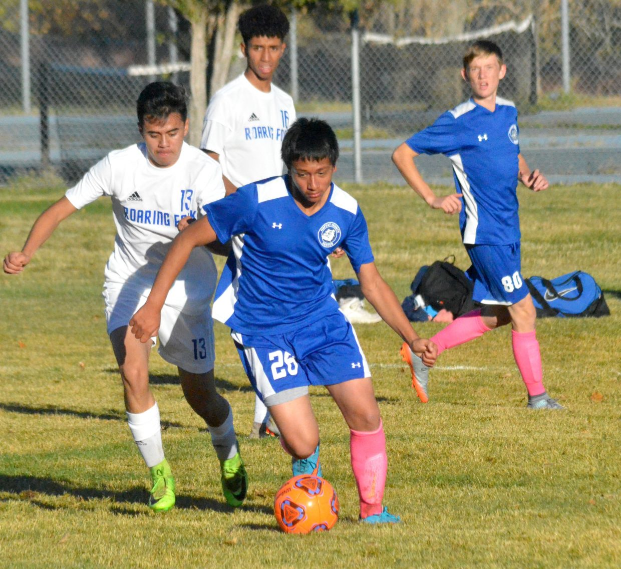 Moffat County High School's Max Rodriguez takes over possession from Roaring Fork.