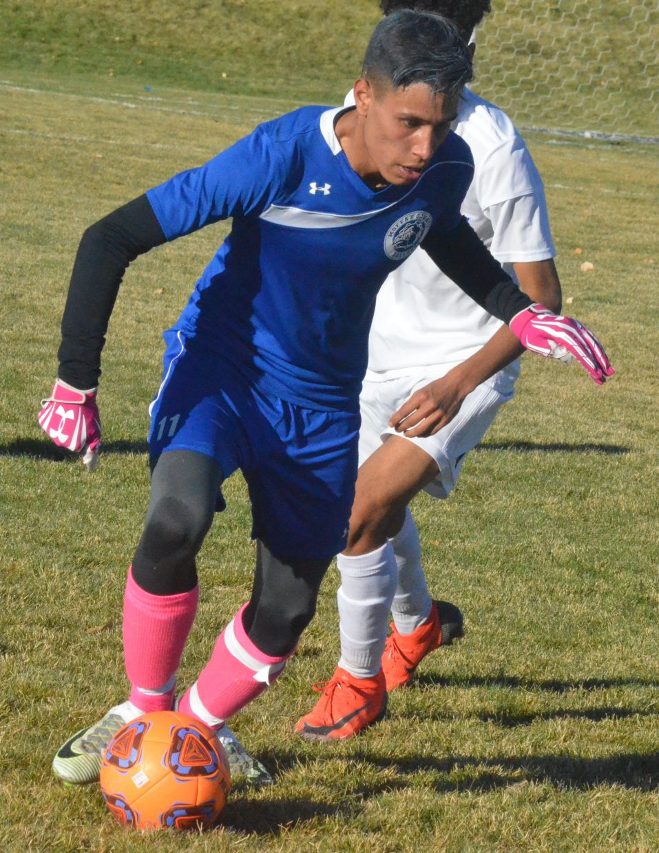 Moffat County High School's Axeel Mendoza looks to turn the ball around against Roaring Fork.