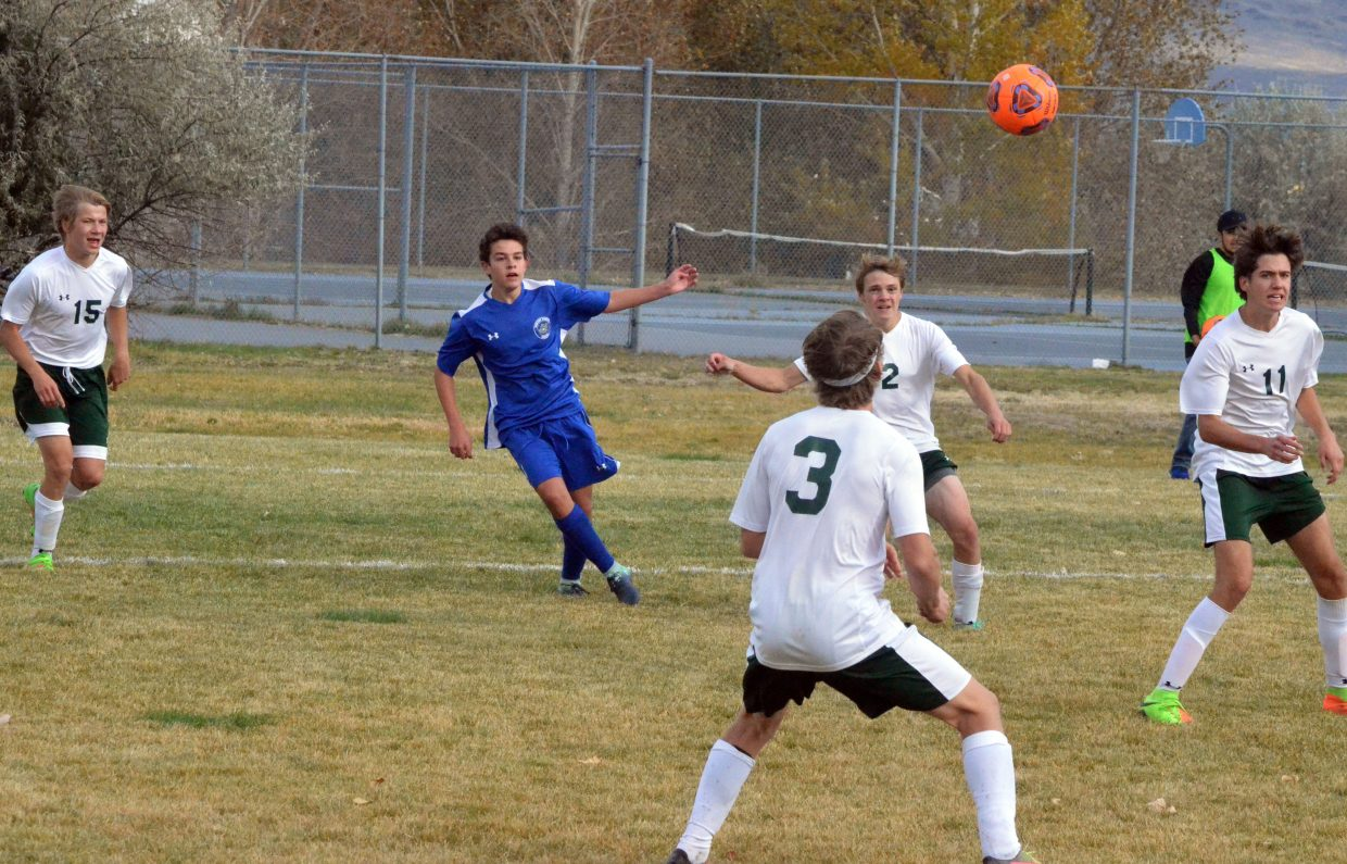 Moffat County High School's Guillermo Estecha fires a long pass against Colorado Rocky Mountain School.
