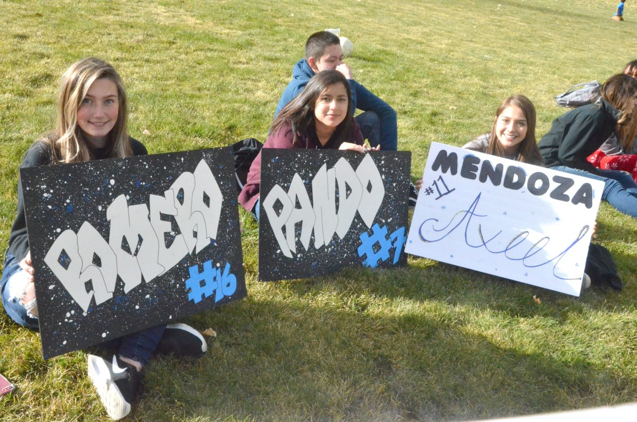 Moffat County High School soccer fans display their signs made for Senior Night for Pedro Romero, Josh Pando and Axeel Mendoza.