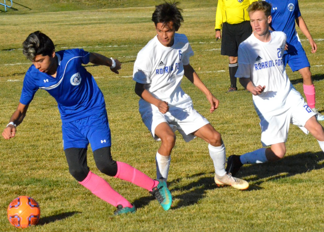 Moffat County High School's Erik Payan gets the ball going in a different direction against Roaring Fork.
