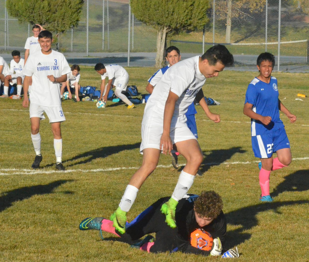 Moffat County High School's goalie Miguel Zaragoza dives on the ball against Roaring Fork.
