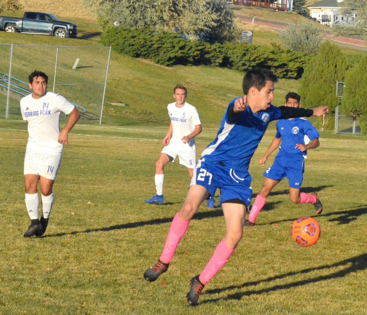 Moffat County High School's Hector Luna Meza bounces a pass off his chest.