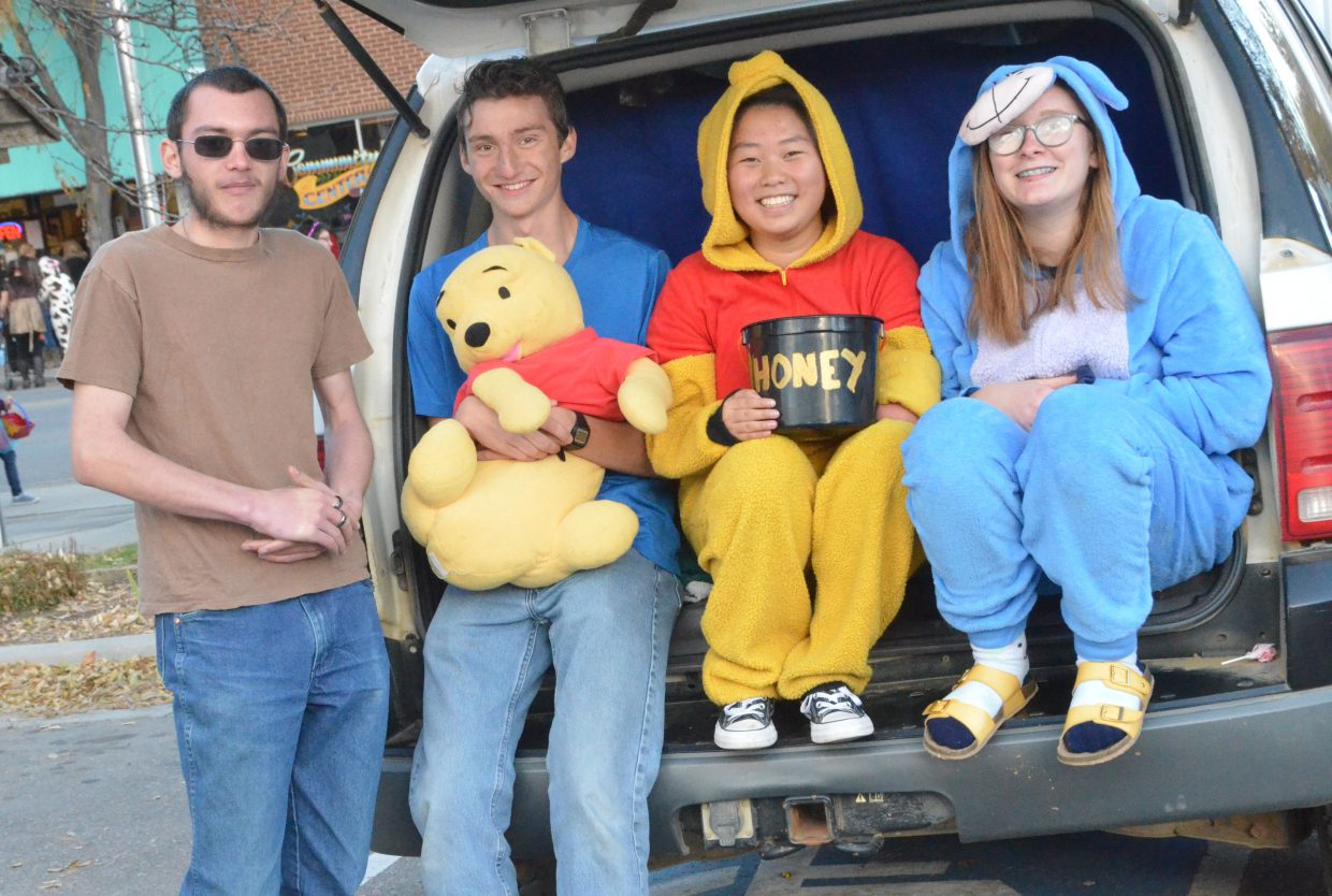 Moffat County High School students dress as denizens of the Hundred-Acre Wood for their Trunk or Treat display Wednesday during Trick or Treat Street along Yampa Avenue and Victory Way.