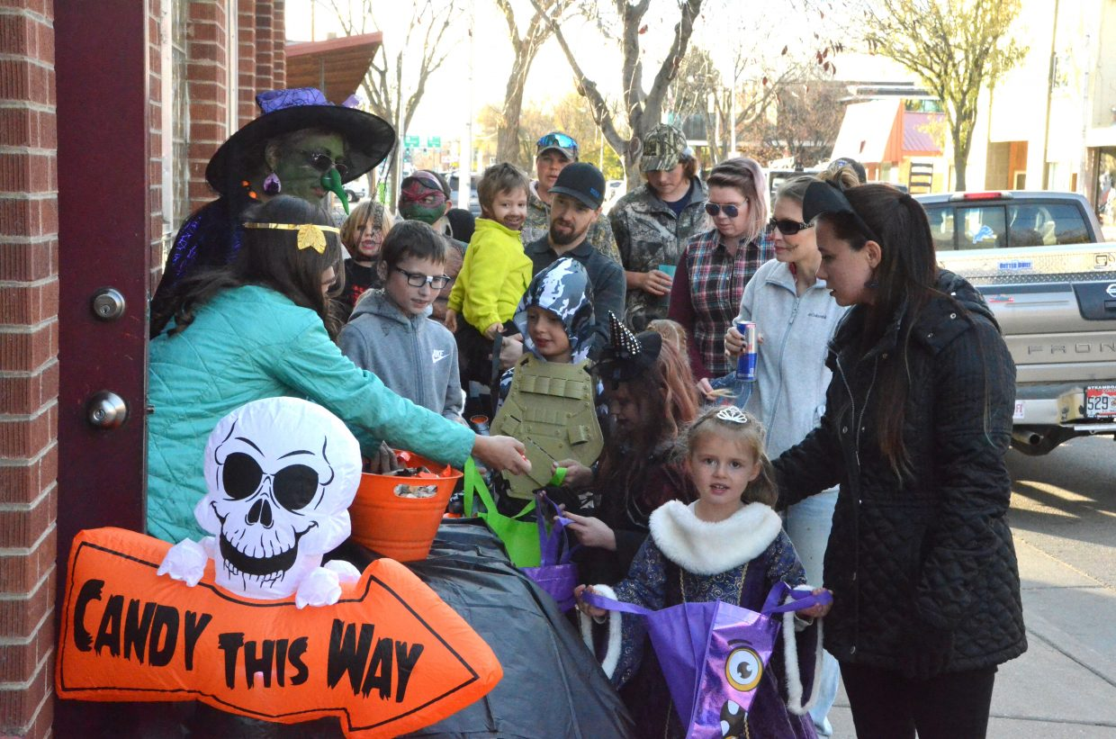 The Popular Bar provides plentiful candy Wednesday during Trick or Treat Street along Yampa Avenue and Victory Way.