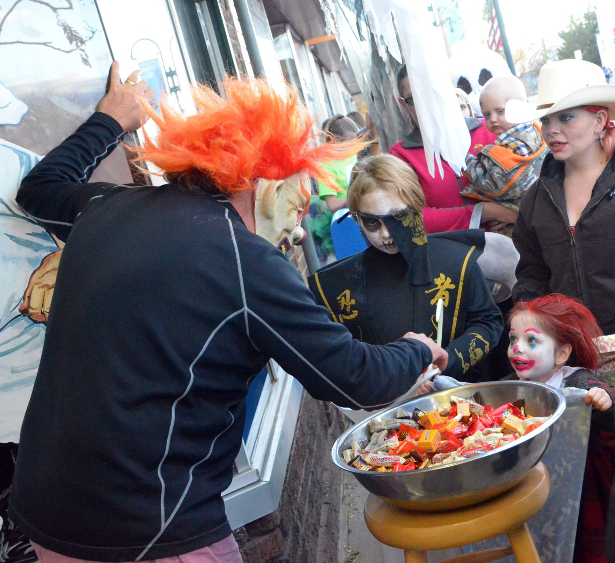 Costumed kids look for candy at Carelli's during Trick or Treat Street along Yampa Avenue and Victory Way.