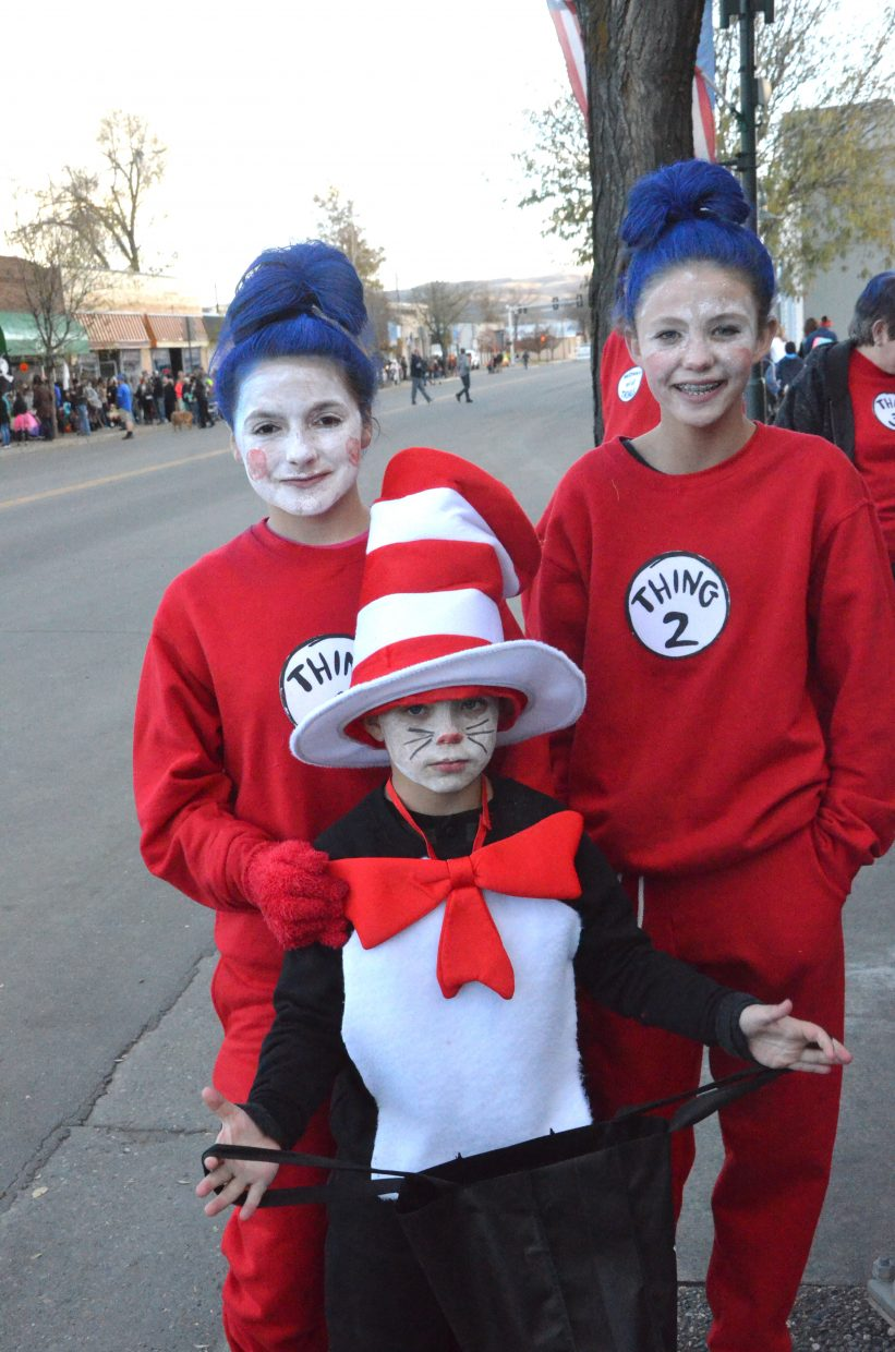 The Cat in the Hat and Thing 1 and Thing 2 take a break during Trick or Treat Street along Yampa Avenue and Victory Way.