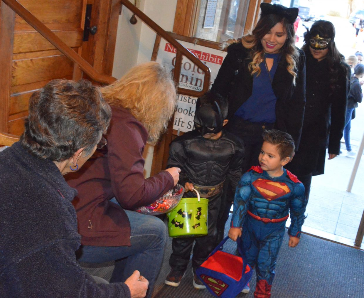 Batman and Superman collect candy at Museum of Northwest Colorado Wednesday during Trick or Treat Street along Yampa Avenue and Victory Way.