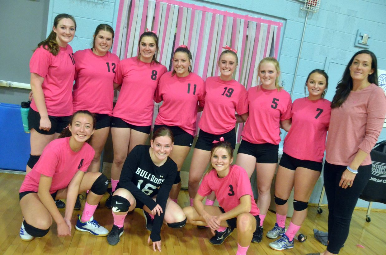 Members of the Moffat County High School varsity volleyball team display their pink apparel after Tuesday night's game. The evening was part of Breast Cancer Awareness Month.