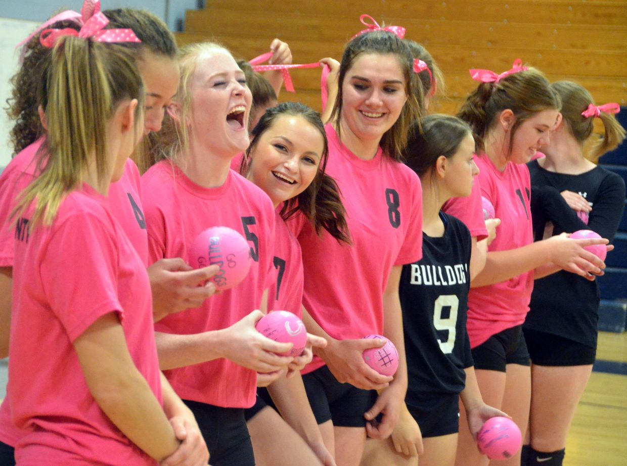 Moffat County High School volleyball players are full of energy during introductions leading up to the game against Central.