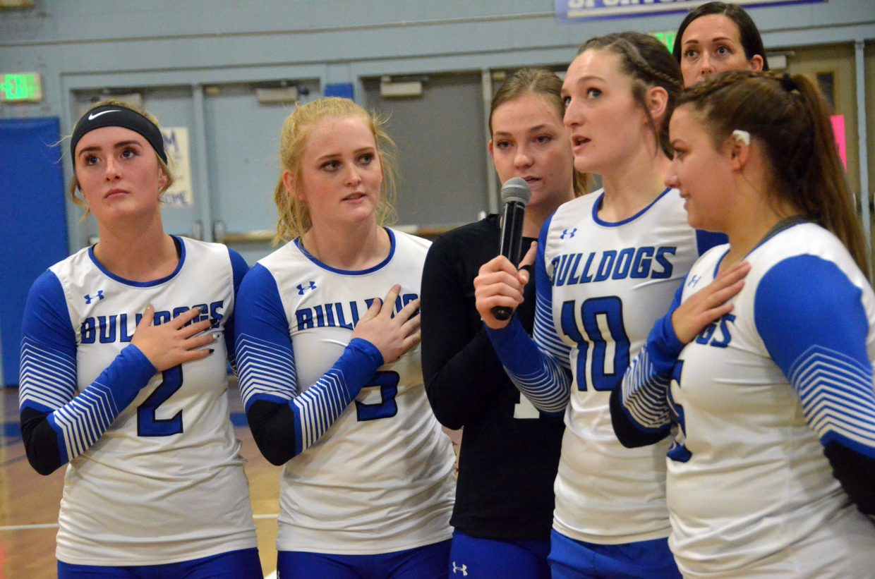 From left, Moffat County High School seniors Bailey Lawton, Jaidyn Steele, Terry Gillett, Tiffany Hildebrandt and Ebawnee Smercina join in the national anthem during Monday's Senior Night game.