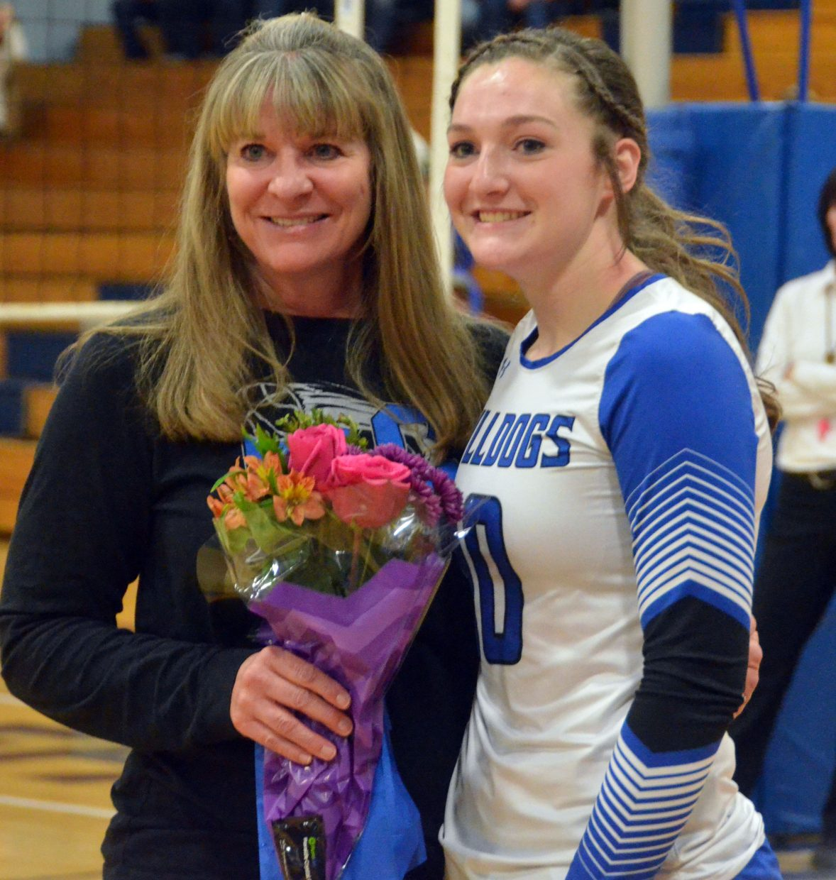 Moffat County High School's Tiffany Hildebrandt is joined by her mother Kathy on the court during the Senior Night ceremony.