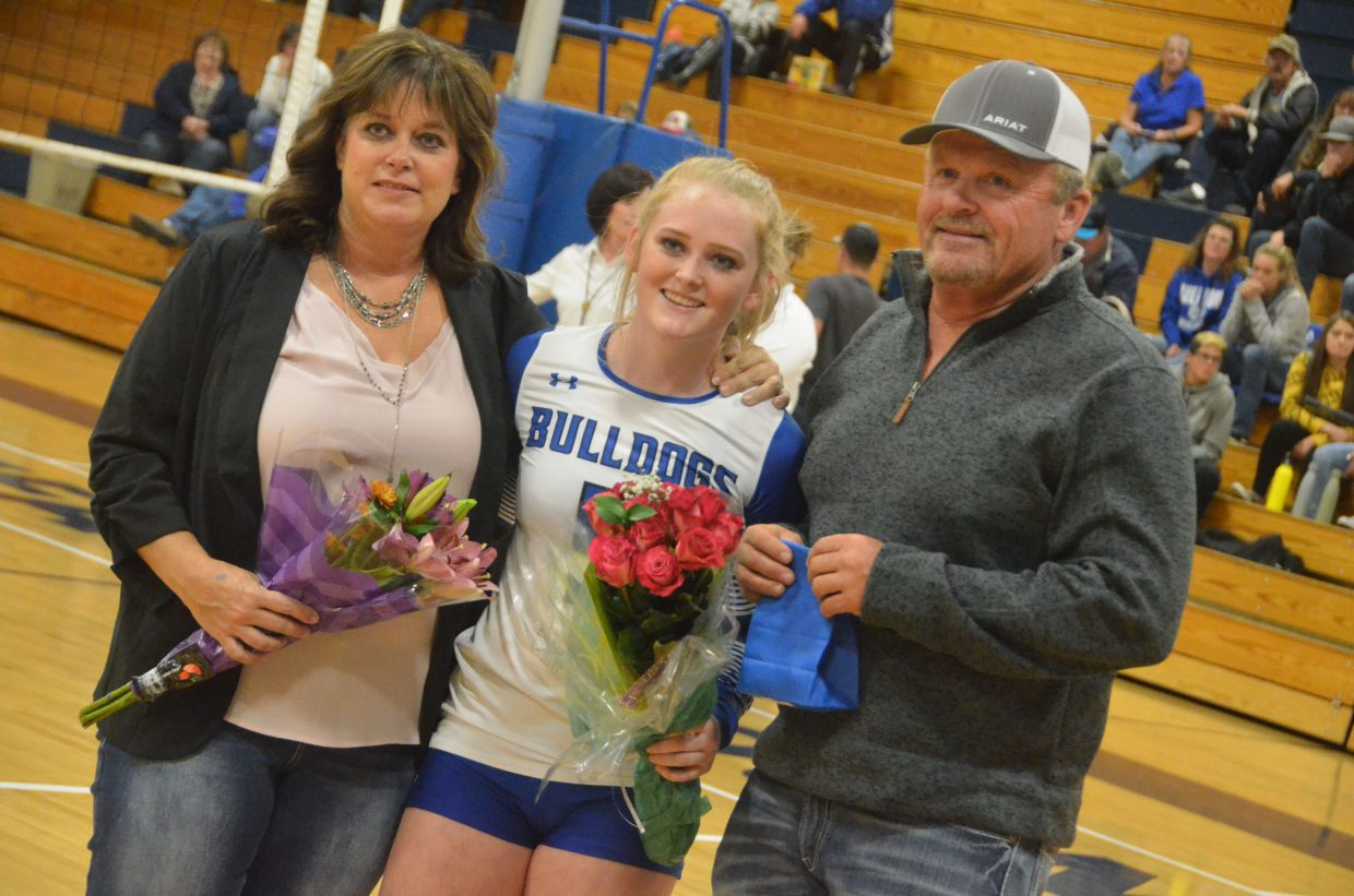Moffat County High School's Jaidyn Steele is joined by her parents on the court during the Senior Night ceremony.