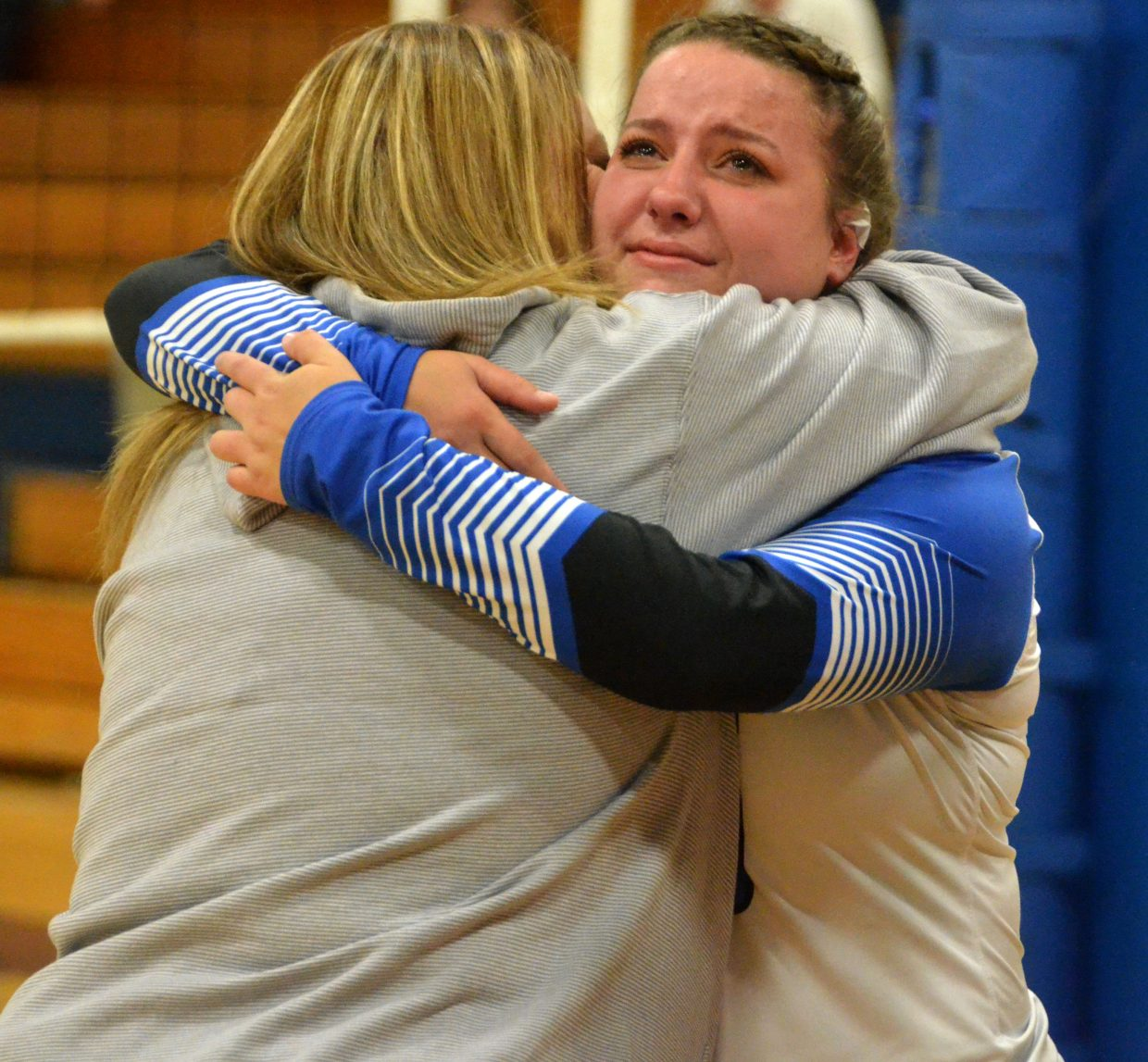 Moffat County High School's Ebawnee Smercina gets teary-eyed  while hugging mother Tylawn during volleyball's Senior Night.