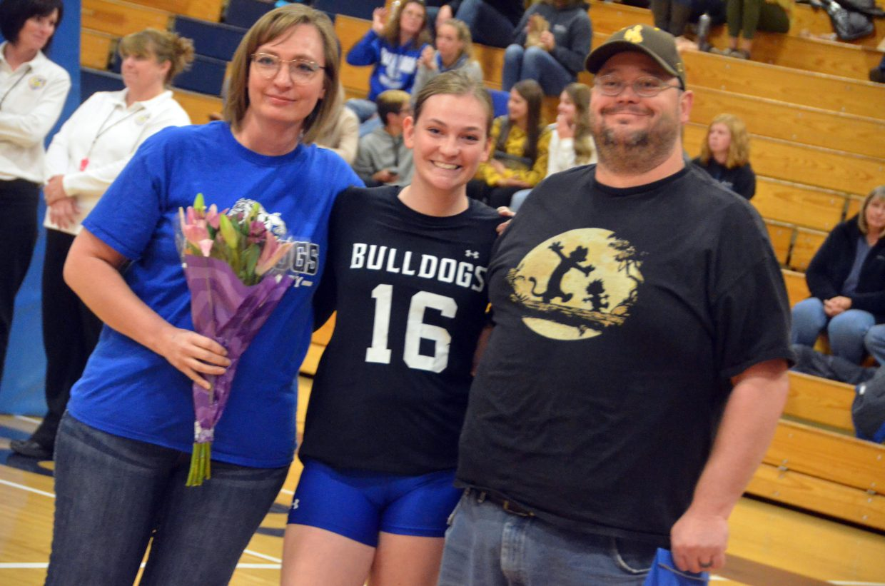 Moffat County High School's Terry Gillett is joined by her parents on the court during the Senior Night ceremony.