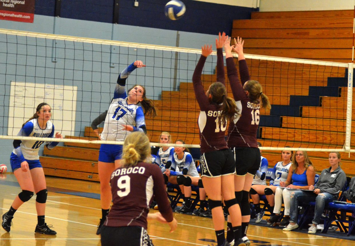 Moffat County High School's Hailee Herndon arcs a shot over the net back to Soroco.
