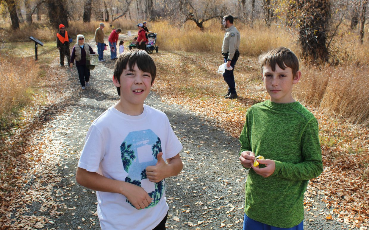 Cameron Campbell and Josef Planansky, both 12, try to determine whether a mysterious piece of candy is peppermint- or cinnamon-flavored. The two friends were enjoying Yampa River State Park's Hike or Treat event Saturday with Cameron's family.