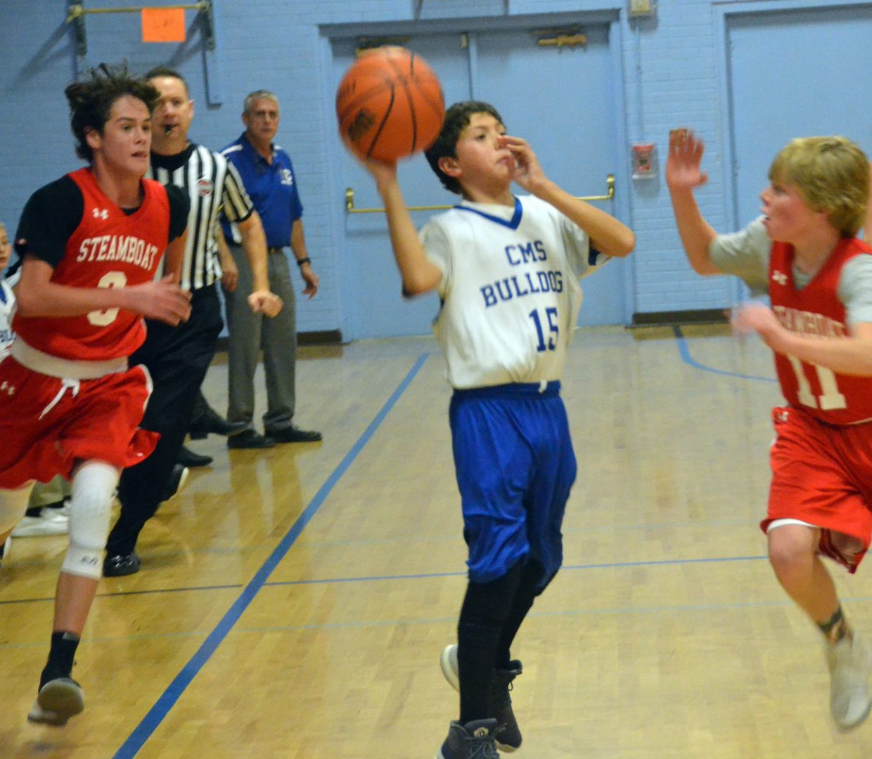 Craig Middle School's Marcus Pech launches a buzzer-beating three-pointer against Steamboat Springs.
