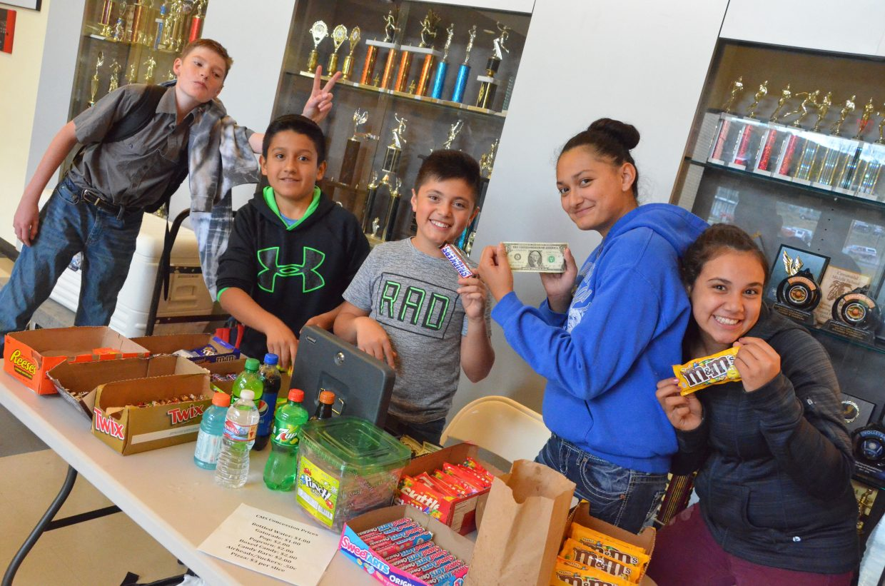 Craig Middle School's concessions crew displays their wares during a CMS basketball game.
