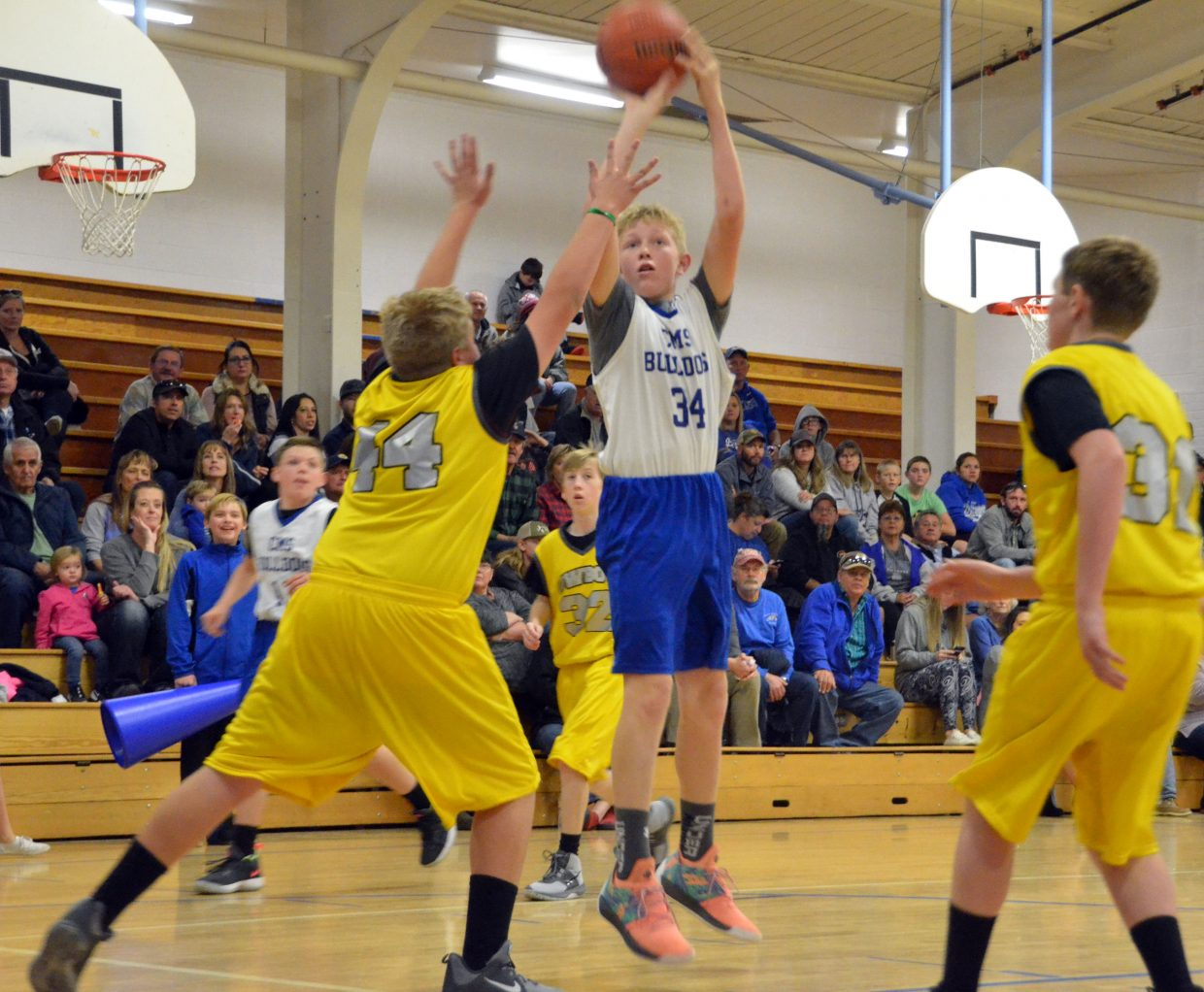 Craig Middle School's Ian Hafey puts up a jumper against Meeker.