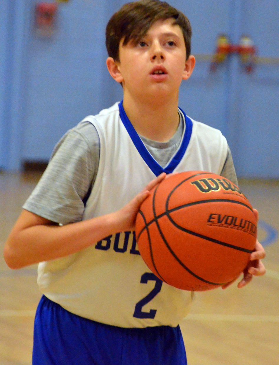 Craig Middle School's Grady Wooden concentrates at the foul line.