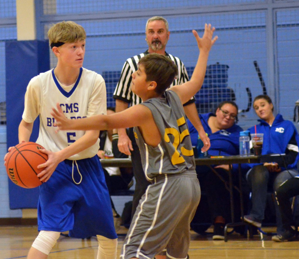 Craig Middle School's Lance Bracket looks to get past his Meeker opponent.
