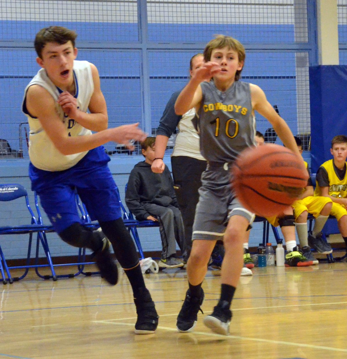 Craig Middle School's Evan Atkin fires a bounce pass into the paint.