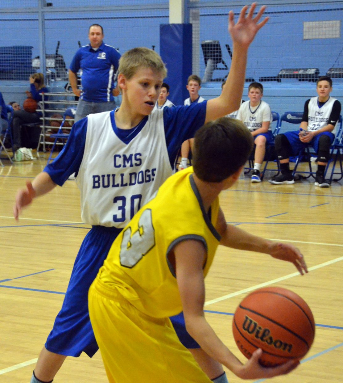 Craig Middle School's Cord Cooper plays close defense against Meeker.