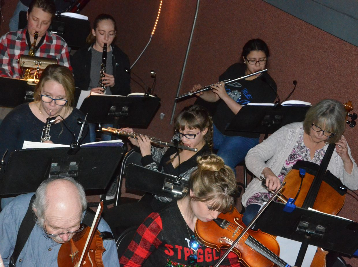 "Musicians tune up in the pit as part of the Moffat County High School production of ""Cinderella."""