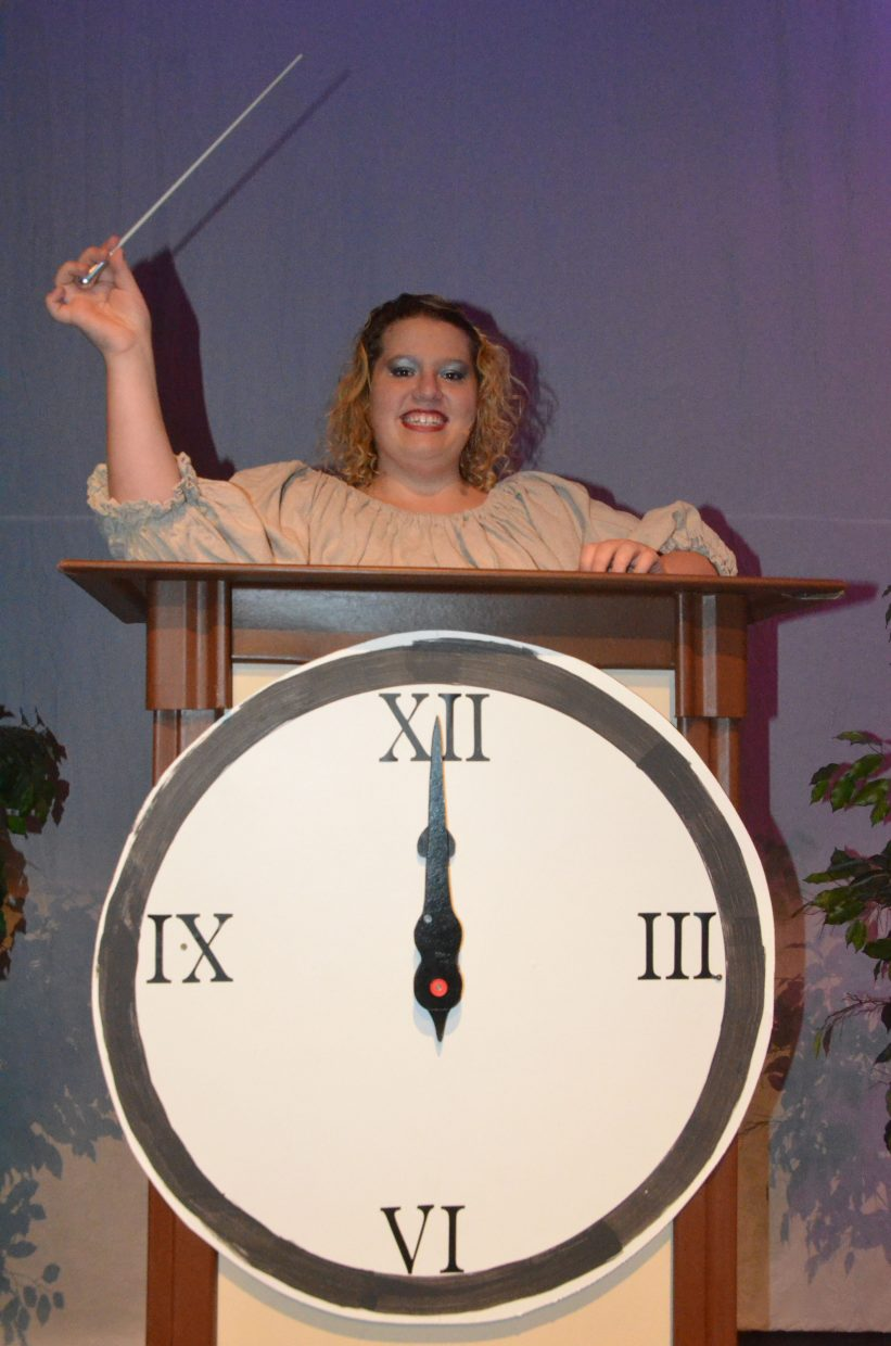 "The fairy godmother (Rachel Updike) shows a midnight deadline is crucial in the Moffat County High School production of ""Cinderella."""