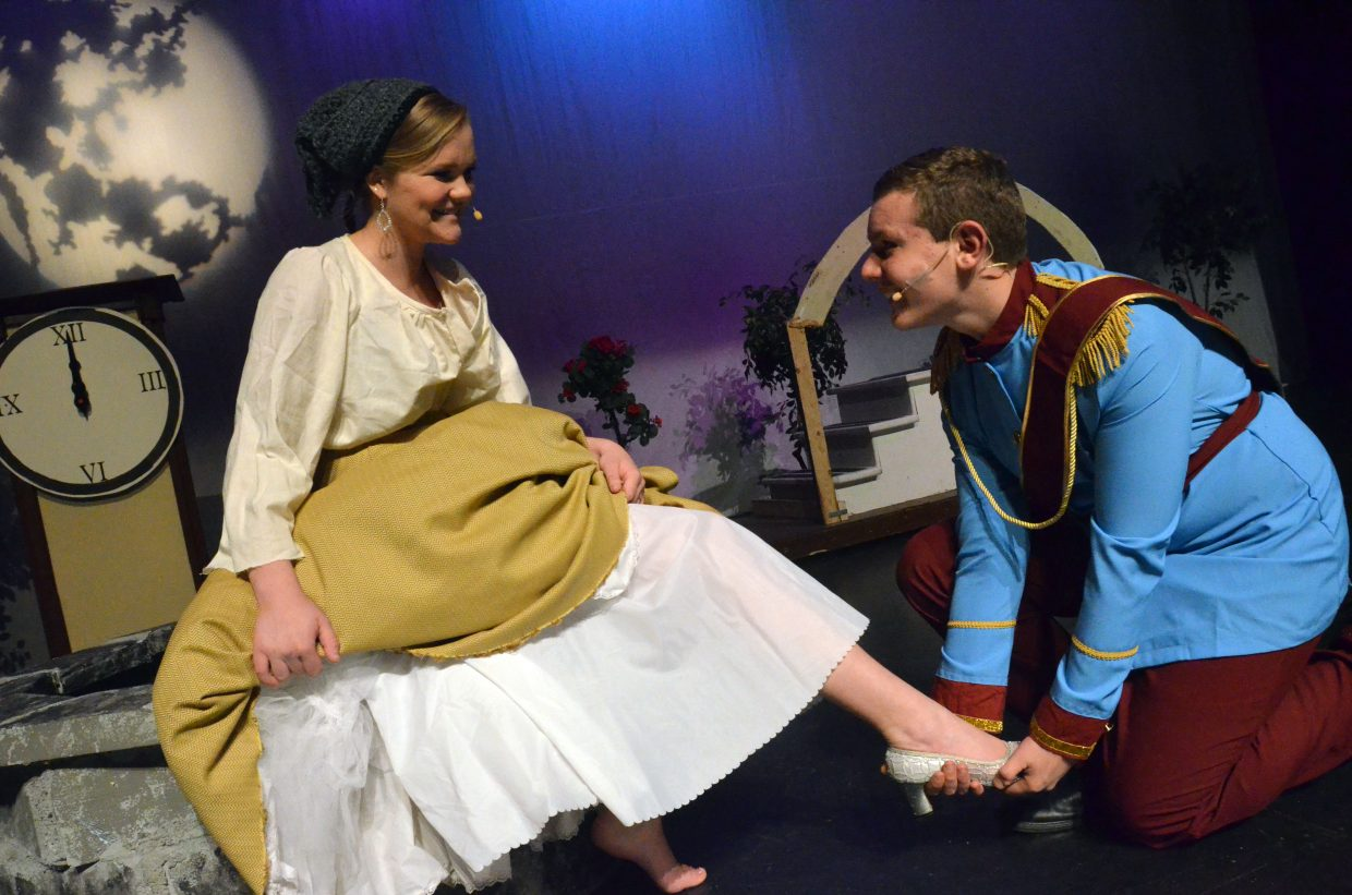 "Cinderella (Caroline Riley) finds a perfect fit while trying on the glass slipper for the prince (Draken Blackwing) in the Moffat County High School production of ""Cinderella."""