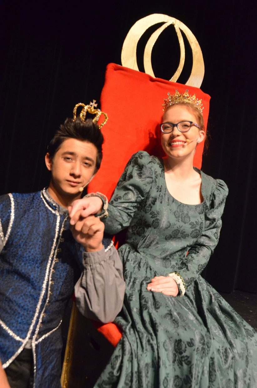 "The king and queen (Sambu Shrestha, Jessica Womble) strike a pose in the Moffat County High School production of ""Cinderella."""