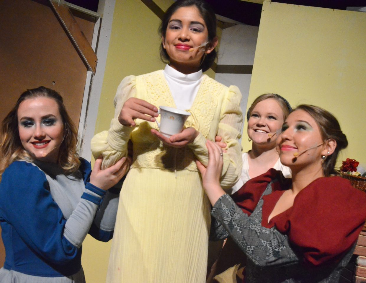 "Cinderella (Caroline Riley) is brushed into the background as her stepmother (Maria Sanchez Silva) and stepsisters (Courtney Smith, Alexa Neton) gather together in the Moffat County High School production of ""Cinderella."""
