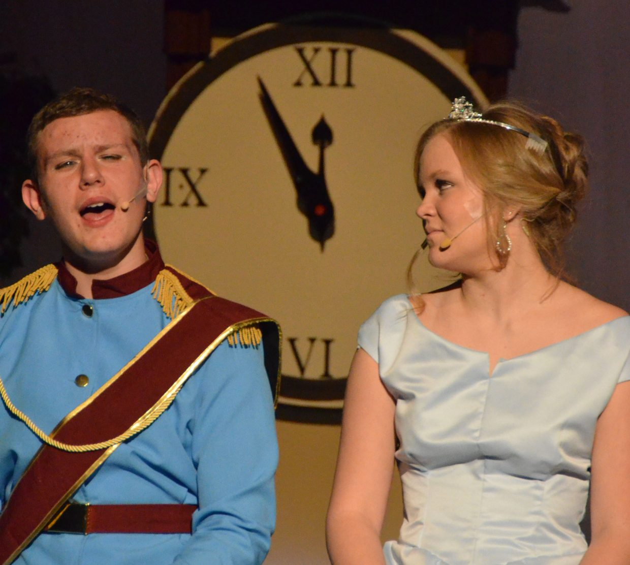 "Time is almost up as Cinderella (Caroline Riley) chats with the prince (Draken Blackwing) in the Moffat County High School production of ""Cinderella."""