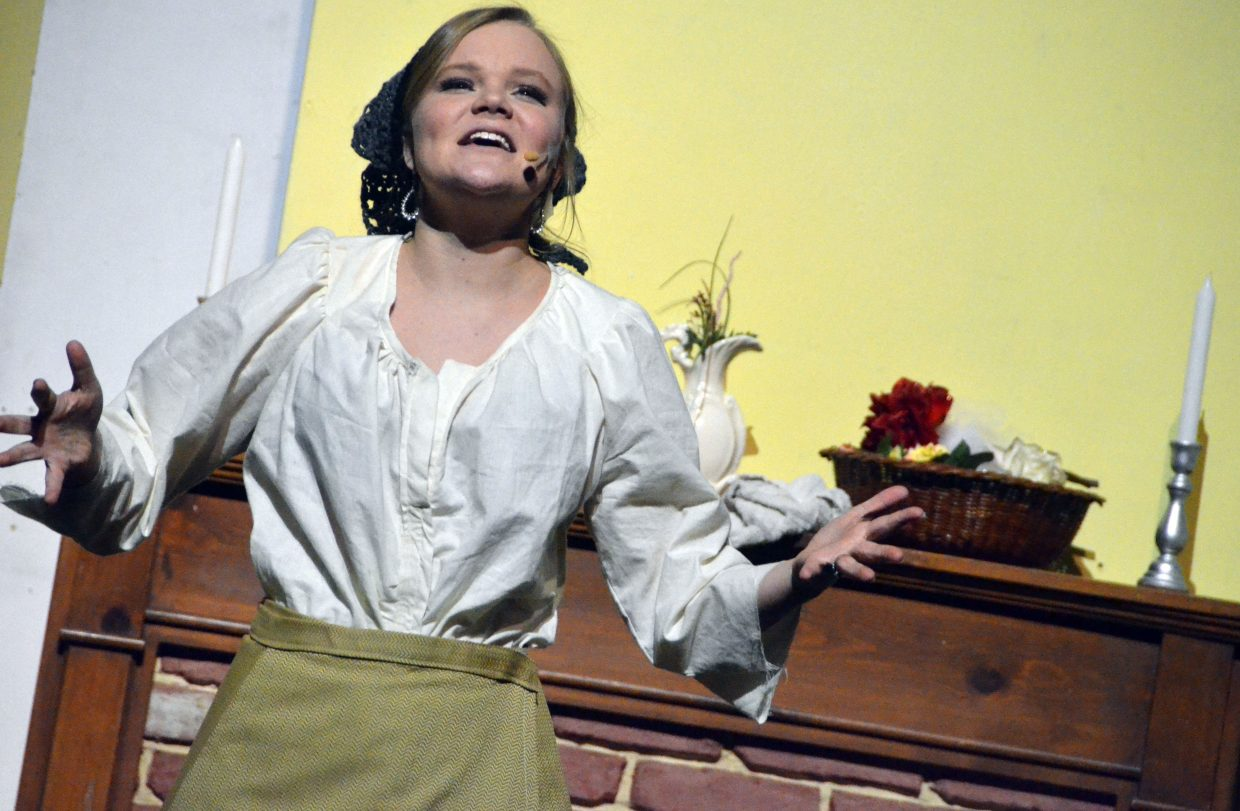 "Cinderella (Caroline Riley) has a rare moment to herself in the Moffat County High School production of ""Cinderella."""