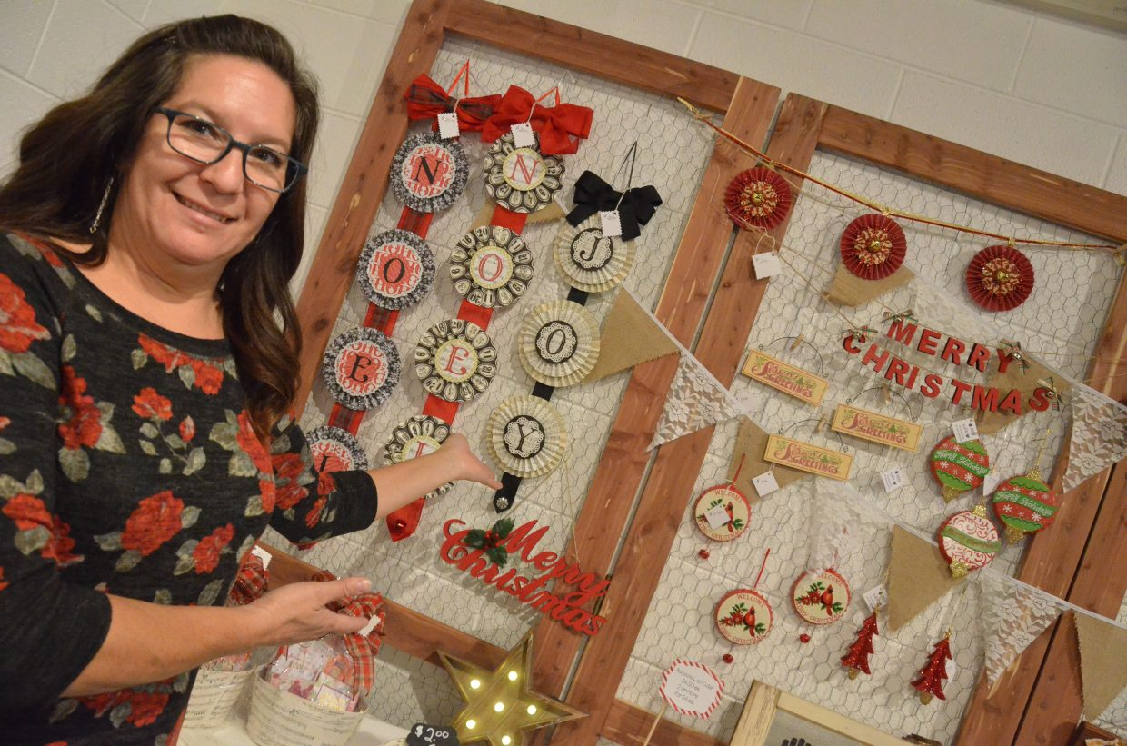 Kim Griffin displays her decorations from Handmade with Love as part of Saturday's Holiday Craft Show at Center of Craig.